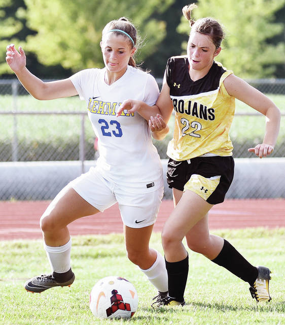 Lehman Catholic's Lindsey Magoteaux, left, and Botkins' Madison Wendel chase after the ball during a Western Ohio Soccer League match on Tuesday in Botkins. The Cavaliers won 9-0.