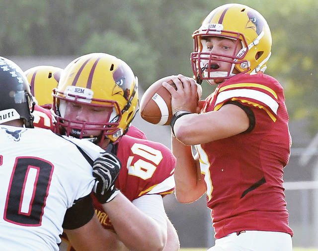 New Bremen junior quarterback Nolan Bornhorst looks to pass during a nonconference game against Mississinawa Valley last Friday. Bornhorst threw for 167 yards and four touchdowns.