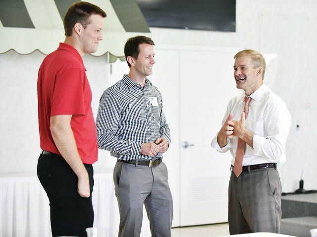 Dustin Schemmel, left, of Fort Loramie, and Matt Purpus, of Minster, talk with Rep. Jim Jordan, R-Urbana, 4th District, during a YPconnect luncheon at the Shelby Oaks Club, Thursday, Sept. 20.