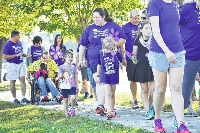 People walk along West South Street during the 2017 Sidney-Shelby County Walk to End Alzheimer's.