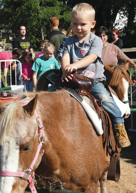 Leo Dietz, 2, of New Bremen, takes a ride on a pony Saturday, Sept. 29, afternoon at the Pumpkinfest in New Bremen. Leo is the son of Jonathan Andrea Dietz.