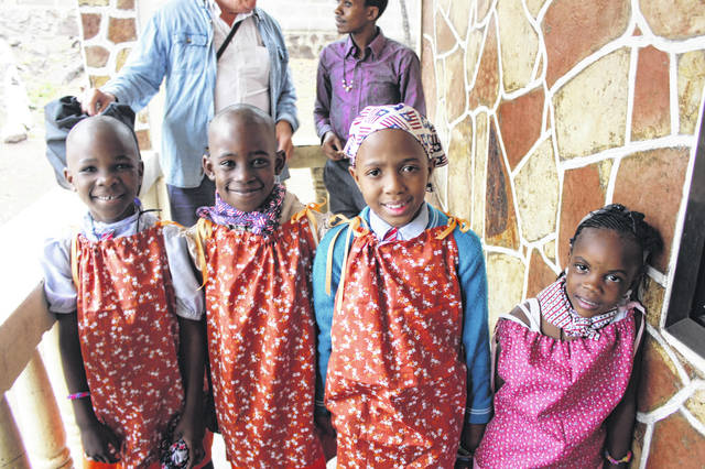 Girls in Tanzania model dresses made during a sew-a-thon.